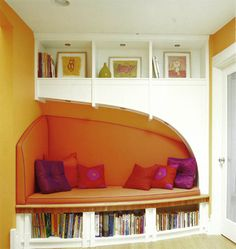 irregularly shaped sofa reading nook in bright colors, looks nice in a guest room or somewhere between a kitchen and living room