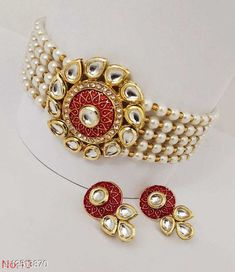 Necklaces & Chains Alloy Jewellery Set Base Metal: Alloy Plating: No Plating Stone Type: Kundan Sizing: Adjustable Type: Necklace Multipack: 1 Sizes: Country of Origin: India Sizes Available: Free Size   Catalog Rating: ★4.3 (476)  Catalog Name: Shimmering Graceful Women Necklaces & Chains CatalogID_2414842 C77-SC1092 Code: 762-12513870-816