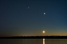 Venus, Jupiter, and the crescent Moon in the western sky after sunset on June 19, 2015. The two bright planets will come within 0.3 degrees of each other on June 30, 2015. (Credit: Brian Ventrudo)
