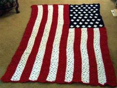 U.S. flag afghan has 264 crocheted granny squares. To finish the project each square has to be hand stitched into strips, then all strips sewn together.