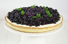 Berry Tart with layer of lemon curd and mascarpone cream topped with fresh blueberries and decorated with sprigs of mint. A bit involved, but sounds worth it