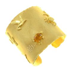 Renato Cipullo Heavy Gold Cuff | From a unique collection of vintage cuff bracelets at https://www.1stdibs.com/jewelry/bracelets/cuff-bracelets/