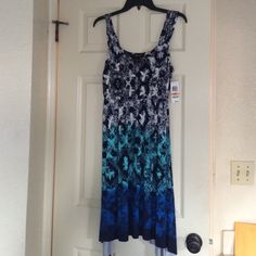 Macy's Style and Company Sundres Never Been Worn w/Tags . Macy's Style and Company Sundress or Work Dress w Shrug or sweater . High-low sides.  Blue, black, aqua and white Macy's Dresses Asymmetrical