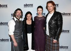 """Ronald D. Moore, Diana Gabaldon, Caitriona Balfe, and Sam Heughan pose together at the STARZ """"Outlander"""" fan event."""