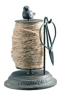 Garden twine holder with scissors. Cute way to hold something utilitarian.