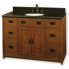 Mission style vanity.  Black marble on the top would be gorgeous.