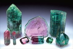 Tourmaline (elbaite) from the Dunton mine, Newry, Maine. A selection of some of the crystals, and stones cut from them, that were found in the extraordinary pocket discovery of 1973. Wendell Wilson photo.