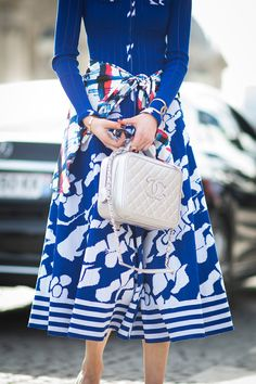 A cobalt printed skirt paired with a sweater.