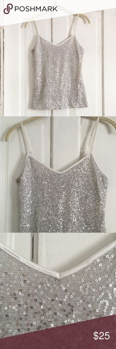 Express Silver Sequin Top w/ White Lining. This top is beautiful. Perfect with jeans or dressed up. Lightly worn. Express Tops