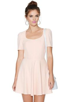 If you're trying to look really cute, then you definitely need this blush dress featuring a scoop neckline, fitted, waist, and cutouts at back.