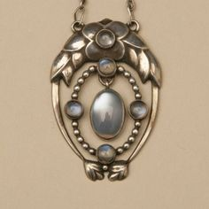 Georg Jensen Very Rare Pendant with Moonstones, no. 8, Handmade Sterling Silver.  ca. 1915 - 1927.