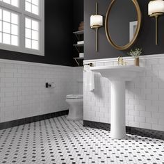 Create a dramatic look in your bath with penny tile and brass accents. A pair of sconces provide a modern alternative to traditional vanity lighting.