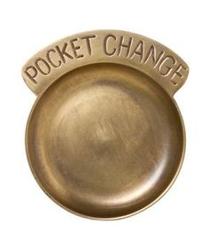 Stylish enough for even the most opulent of entryways, this brass dish makes spare change look so tempting.