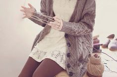 I really love this look with the white dress with lace detailing, the oversized cardigan, and the brown leggings.