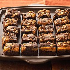 Marbled Chocolate-Pumpkin Brownies | Swirl a layer of cream cheese and pumpkin into chocolate batter to create these luscious brownies, and sprinkle walnuts on top for extra crunch.