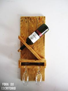 Wine rack for a bottle and 2 glasses, made from a pallet. Here are the instructions on how to make it! http://www.instructables.com/id/Wine-rack-for-a-bottle-and-2-cups-out-of-pallet/ -RM: