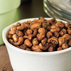 Chili-Roasted Black Eyed Peas  Turn canned chickpeas or black-eyed peas into a unique and affordable party snack. Simply toss them in olive oil with a few seasonings and roast until crisp. The key is to bake the beans as long as possible without letting them burn. This will dry them out, making them extra-crunchy like nuts. Enjoy by the handful or sprinkle over a salad.