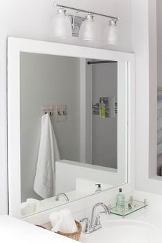 How to frame a bathroom mirror - a budget friendly DIY project that can easily elevate your bathroom with little effort.