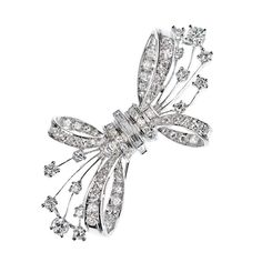 Diamond Bow Brooch in White gold | From a unique collection of vintage brooches at https://www.1stdibs.com/jewelry/brooches/brooches/
