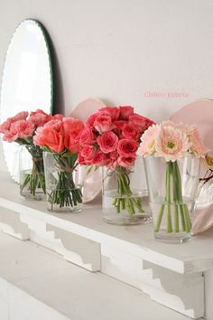 Different pops of pink flowers. Simple  + elegant decor...