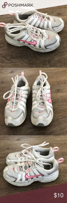 Girls white Nike tennis shoes Girls size 2 white Nike's with pink detail.  Great shape, not much wear & tear. Shoes Sneakers