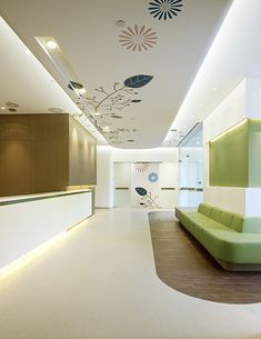 Portfolio - american sino hospital audong clinic - robarts interiors and architecture Healthcare Architecture, Healthcare Design, Architecture Portfolio, Interior Architecture, Interior Ceiling Design, Clinic Interior Design, Clinic Design, Ceiling Decor, Commercial Design
