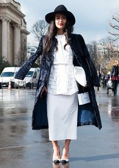 White on white, with black printed coat + wide-brim hat