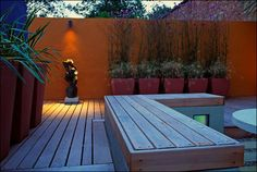 Awesome Back Yard Modern Deck Orange Wall Design with lighting in bench