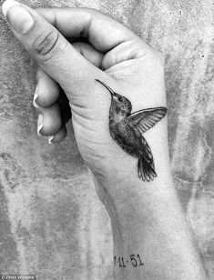 A hummingbird tattoo that Zelda Williams got in honor of her father, Robin Williams. I like the placing...