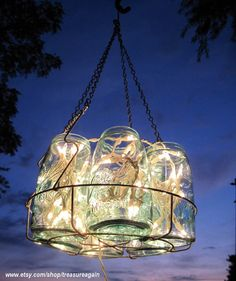 Mason Jar Chandelier! Gotta do this with my jars that have chipped around lip and can't be used for canning anymore! you can get battery operated light strands so they dont have to be hooked to electric.