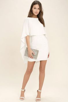 Things are looking up with items like the Best is Yet to Come White Backless Dress making their way into your wardrobe! A unique, backless silhouette is created by woven poly fabric that drapes into a front tier, and cape sleeves that trail alongside the sheath skirt. Hidden back zipper. #Clubdresses