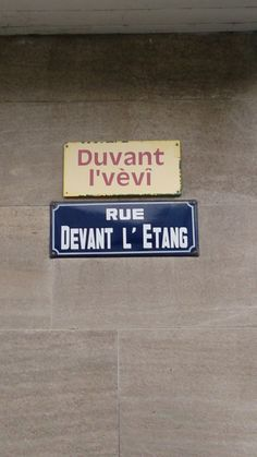 Street names in Wallon and French, Malmédy, Belgium