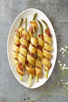 Puff pastry gives these prosciutto-wrapped asparagus stalks a buttery, flaky shell.   Get the recipe from Good Housekeeping »