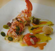 Lobster Salad Malagueña. INGREDIENTS FOR FOUR PEOPLE .2 blue lobsters than 500 g each / 4  Spring Onions/ 4 potato / 4  Black olives / 4 Picos Bread / 25 slices of black truffle / Tuber melanosporum /1 Orange with skin/ Black olive paste / Outbreaks tarragon, borage, chervil and basil / balsamic vinegar, lobster oil, herb oil black olive oil, salt scented herbs, Maldon salt.cooking : 40 minutes