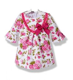 Precioso vestido de moda infantil para niña de piqué blanco estampado en flores fusia