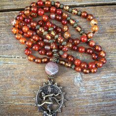 Carnelian and amber mala. With a frosted multicoloured amazonite guru, and a nataraja guru. For more imaget see my page mala mania on Facebook, or follow mala_mania on instagram