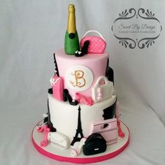 Fondant Birthday cake with Eiffel Tower, Shoes, Purses, and Travel by Sweet By Design in Wylie, Texas