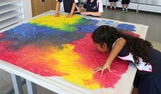 Verbosity: Paint between tablecloths.  This was such a great lesson and the kids loved printing faces and ears into the paint, and mixing the colours.