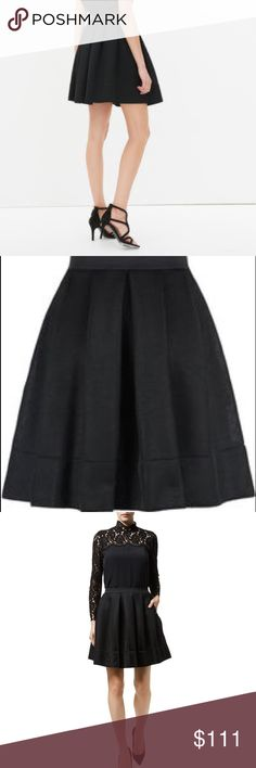 brand new sandro black skirt hiver size is sandro size 2. you cannot see how it really looks like from picture! It is.really hard to make you see that! It is much much fluffy than most of skirt which makes your leg looks very thin! Believe me! You should buy it and have a try to see the magic of sandro! Sandro Skirts Mini