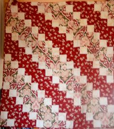 This quilt is going to warm someone right up with its colors of fall it reminds me of cinnamon and coffee on a cold day and it is a large quilt and very heavy. Amazing anonymous quilter once again!