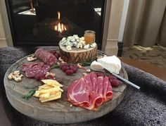 Curl up by the fire with a glass of wine and this gourmet charcuterie board at Waldorf Astoria Park City.