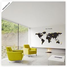 WOW! This is it! World map as a wall, then attach pictures from each trip you take with pins and string.