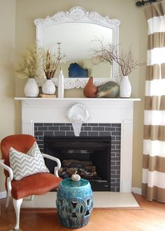 Balance out traditionally dark and heavy autumn decorations, with a crisp white! Don't have a white mantle? Add white ceramic vases instead.
