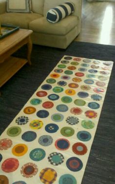 diy rug.My canvas floor cloth.I mod podged  fabric circles on canvas, then polyurethane