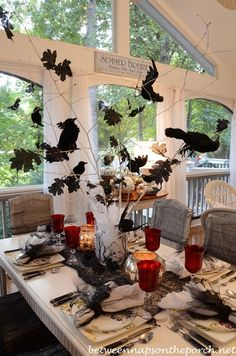 Halloween Tablescape with Crow Tree Centerpiece. Red glasses could be used for Halloween and Christmas table setting. Halloween Wedding Centerpieces, Halloween Table Settings, Tree Centerpieces, Halloween Party Decor, Holidays Halloween, Halloween Themes, Halloween Crafts, Vintage Halloween, Halloween Foto