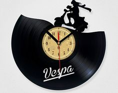 Vinyl Record Clock - Vespa. Vinyl Eaters is an upcycling product made from old vinyl records. Cool gift ideas for music lovers.