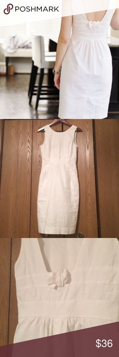 "JCrew Back Bow White Dress 2 Beautiful and unique JCrew back bow dress size 2. In really great condition after being worn twice. The sole flaw are the bra keeps that unraveled, but I found they were unnecessary anyway. 37.5"" long and 14"" waist. Has pockets! J. Crew Dresses Midi"