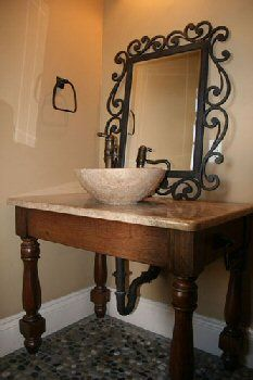 stone vessel sink on farmhouse vanity table