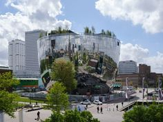 "MVRDV has completed the bowl-like Depot Boijmans Van Beuningen in Rotterdam's Museumpark, which is covered in mirrored glass and topped by a ""rooftop forest""."