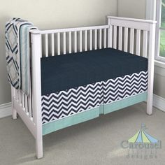 Crib bedding in Mist Stripe, Navy and Gray Geometric, Solid Navy Minky, White and Navy Zig Zag, Solid Seafoam Aqua Minky. Created using the Nursery Designer® by Carousel Designs where you mix and match from hundreds of fabrics to create your own unique baby bedding. #carouseldesigns